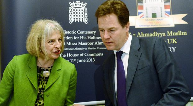 Home Secretary Theresa May and Deputy Prime Minister Nick Clegg are at odds on plans for a so-called