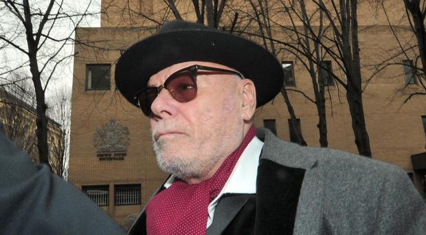 Former pop star Gary Glitter, whose real name is Paul Gadd, leaves Southwark Crown Court in London