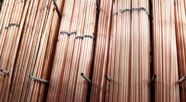 An analyst said the World Bank downgrade and collapsing industrial metal prices such as copper