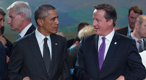 Barack Obama (left) and David Cameron are to hold talks in Washington