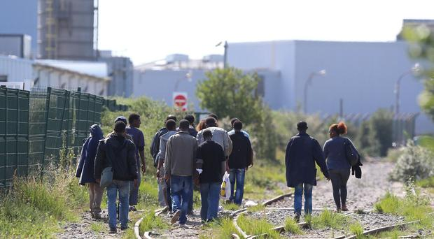 Migrants in Calais wait for a chance to cross the Channel