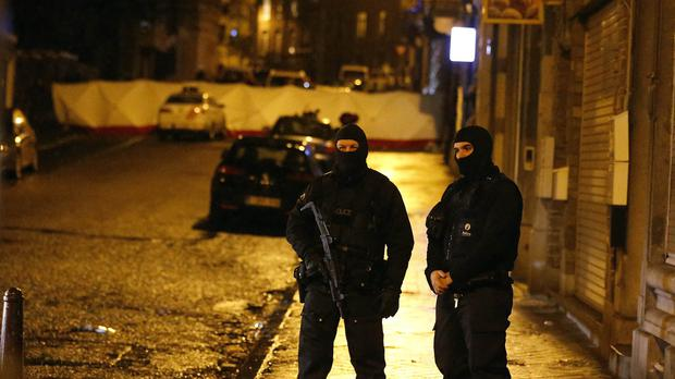 Belgian police officers guard a street in Verviers (AP)