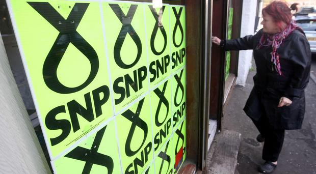 Labour has cut the SNP's lead to 10 points but is expected to lose half its 40 Scottish seats in Westminster, according to a poll