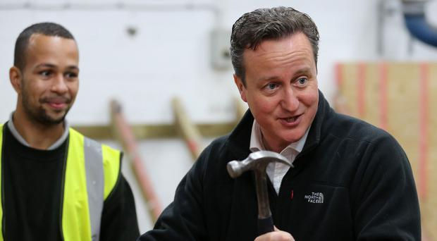 Prime Minister David Cameron during a visit to J Wright roofing college in Nottingham.