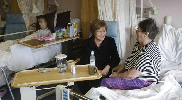 Nicola Sturgeon (centre) said the SNP might vote on English NHS issues at Westminster