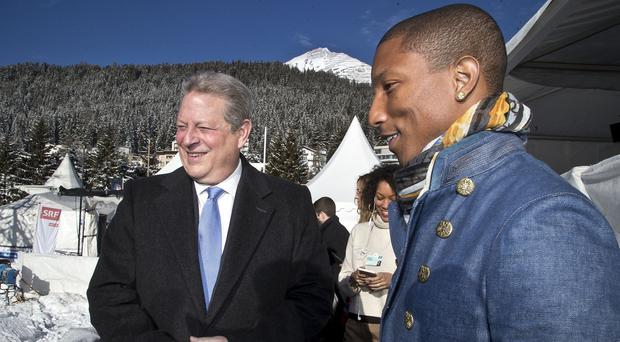 Former US vice president Al Gore and singer Pharrell Williams talk at the World Economic Forum takes place in Davos, Switzerland (AP)