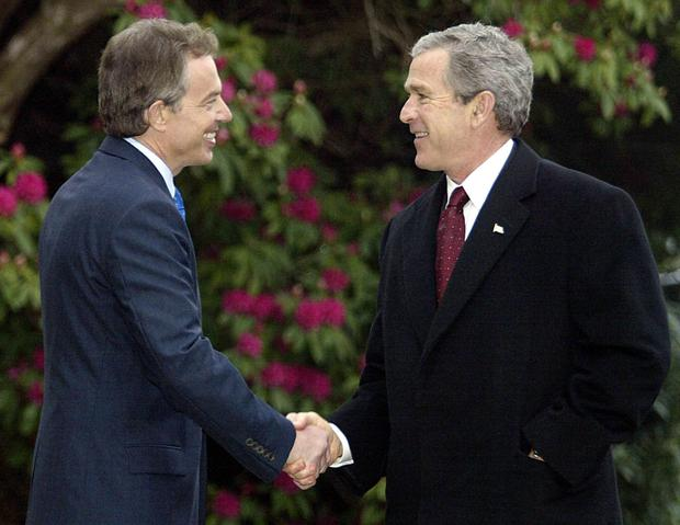 US President George Bush greets Tony Blair at Hillsborough in 2003, where they discussed Iraq