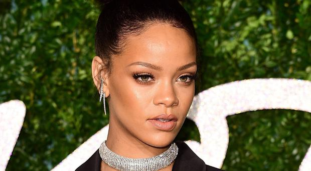 Topshop is appealing after a court ruled their use of a picture of pop diva Rihanna on a T-shirt was illegal passing off