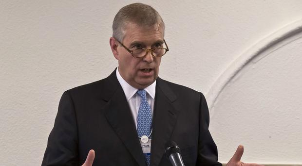 The Duke of York gestures as he speaks to business leaders during a reception at the sideline of the World Economic Forum in Davos.