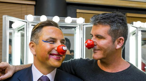 David Walliams, left, says all the profits from his new book are going to Comic Relief