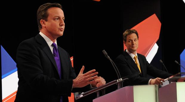 David Cameron, left, says he wants to take part in the televised debates