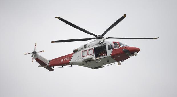 A Coastguard Rescue helicopter is searching an area in the south east of the Channel