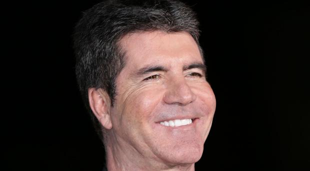 Simon Cowell is looking for a Latino band for his new talent show