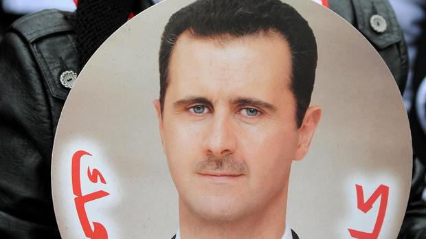 The West's latest 'Arab Hitler' continues to rule despite the widespread predictions of his downfall. Just what is the man's secret, asks Robert Fisk
