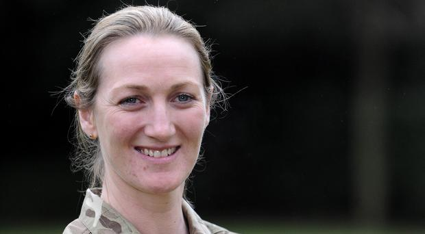 Chinook helicopter pilot Flight Lieutenant Laura Nicholson and her crew came under attack during two back-to-back rescues in Afghanistan