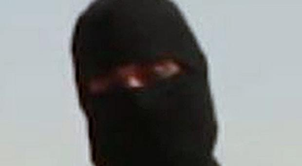 The extremist known as Jihadi John claims British spies warned him they were 'keeping an eye on' him