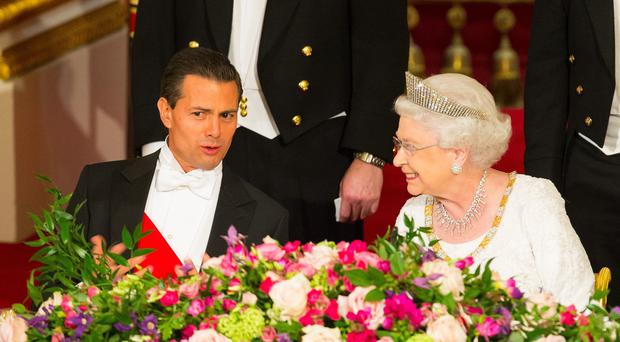 Mexican leader Enrique Pena Nieto and the Queen speak during a state banquet at Buckingham Palace