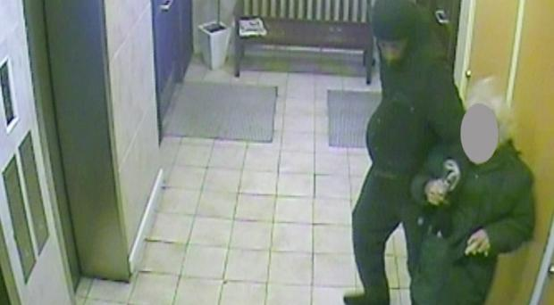 CCTV of the moment Soloman Bygraves mugged Stanley Evans, 93, for his wallet in the entrance to the flats in Soho, central London, where the pensioner lives (Metropolitan police/PA)