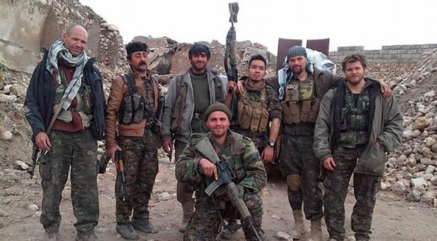 Erik Scurfield, front, with Kurdish fighters and foreign volunteers in Sinjar, Iraq