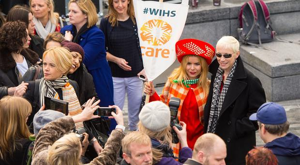 Paloma Faith and Annie Lennox take part in CARE International's Walk in Her Shoes march in central London, to mark International Women's Day