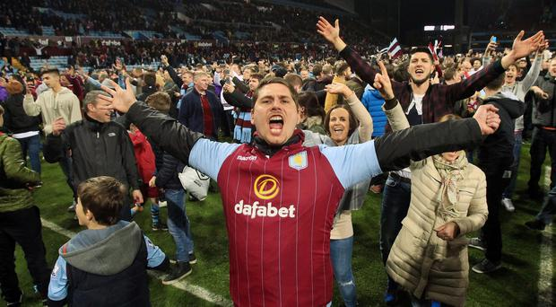 Aston Villa fans invade the pitch after the FA Cup match at Villa Park, Birmingham