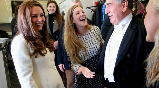 The Duchess of Cambridge enjoying a joke with actor Jim Carter, who plays Carson in the series