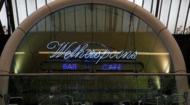 Pub chain JD Wetherspoon said sales were 4.5% higher on an underlying basis in the six months to January 25 but profits fell 1% to £37.5 million