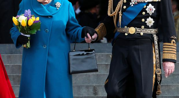 The Queen and Prince Philip leaving the cathedral