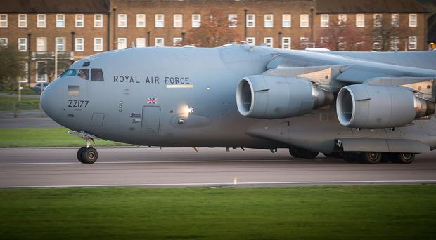 An RAF C-17 transport plane is carrying aid to cyclone-hit Vanuatu