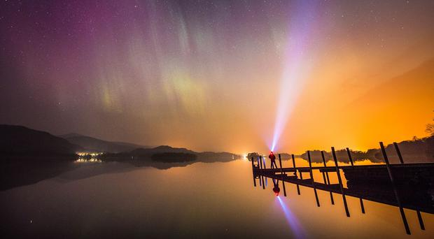 The aurora borealis over Derwentwater, near Keswick in the Lake District