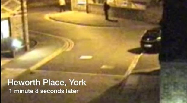 CCTV footage from March 18, 2009 of a man place want to identify (right) leaving Heworth Place, off Heworth Road, a short time later, near the home of missing chef Claudia Lawrence.