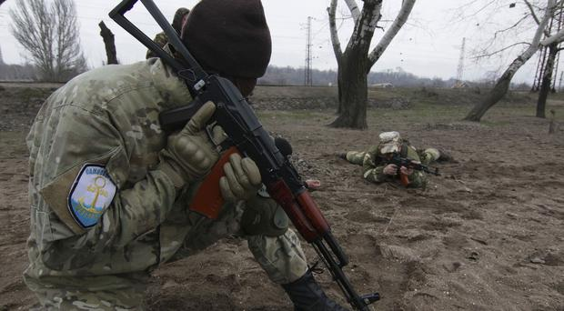 Local volunteers carrying out military training in the Donetsk region of Ukraine - British personnel are now in the country (AP)