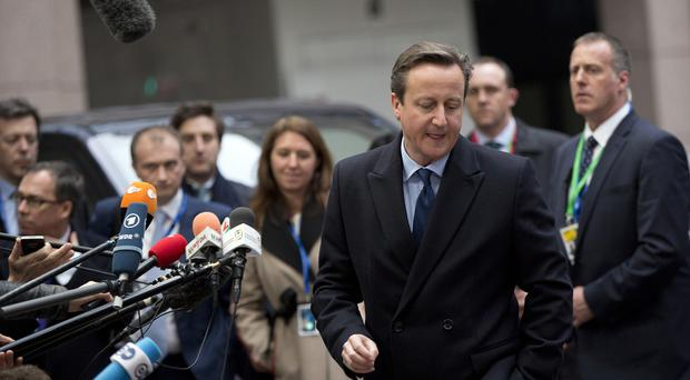 David Cameron arriving for the EU summit in Brussels (AP)