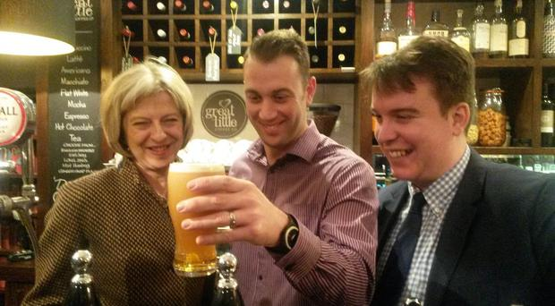 Home Secretary Theresa May meeting pub landlord Phillip Willey and Conservative candidate Craig Williams at The Plough in Whitchurch