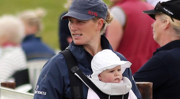 Zara Phillips pictured with her daughter Mia last July