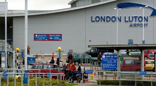 The woman was arrested at Luton airport