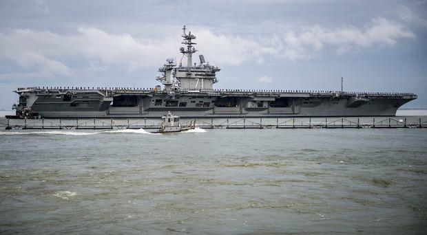 Aircraft carrier USS Theodore Roosevelt which is too big to anchor in Portsmouth Harbour (US Navy/PA)