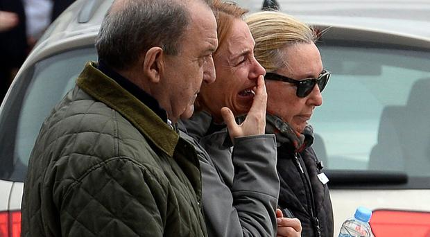 Crying people arrive at Barcelona airport