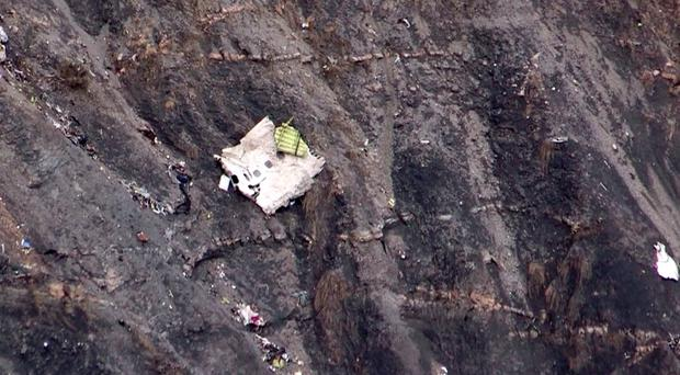 Debris from a GermanWings Airbus A320 at the crash site in the French Alps