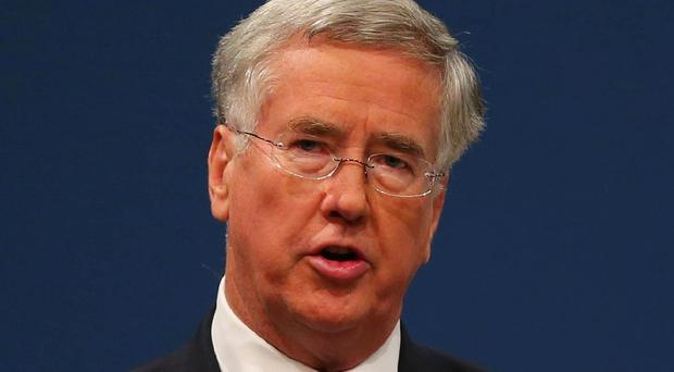 Defence Secretary Michael Fallon said the UK would send around 75 military trainers and headquarters staff