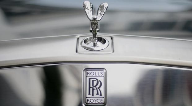 More than 200 Rolls-Royce jobs are being shed at the car maker's plants in Inchinnan, Renfrewshire, and East Kilbride