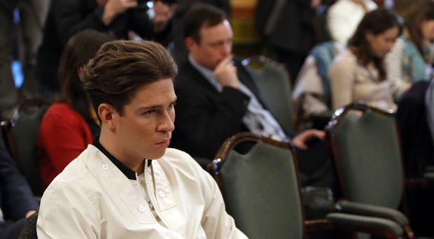 Joey Essex from ITV's The Only Way Is Essex listens during a press conference with Liberal Democrat party leader Nick Clegg in London