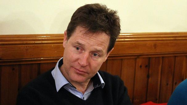 Liberal Democrat leader Nick Clegg speaking with journalists from Scotland's national media at the Thomas Muir Coffee shop in Glasgow