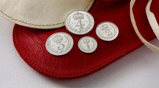 Commemorative Royal Maundy coins, which the Queen will be handing out for the 60th time since her accession to the throne (Royal Mint).