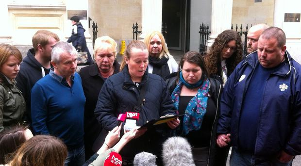 Family liaison officer Michelle Gozna, centre, reads a statement on behalf of Scott and Donna Hussey, to the right of her, outside Bristol Crown Court