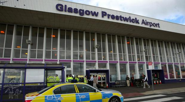 The plane was escorted into Prestwick airport