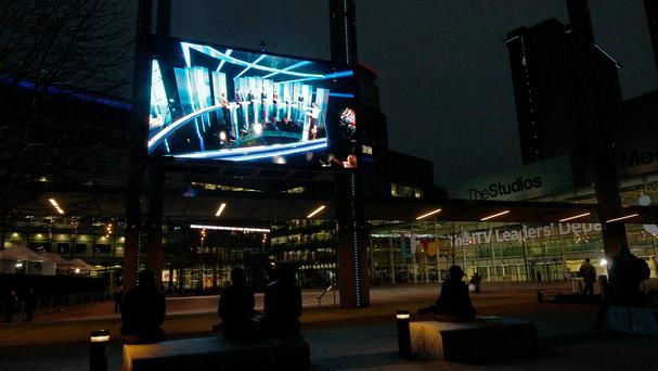 People watching the live leaders' TV debate on a big screen outside the ITV Studios at MediaCityUK in Salford Quays