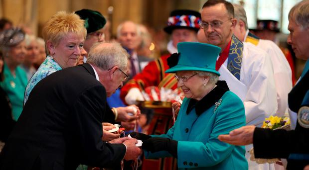 The Queen distributes the Maundy money during the Royal Maundy Service at Sheffield Cathedral yesterday