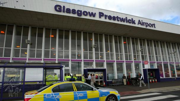 A plane landed safely after being escorted into Prestwick Airport by Typhoon jets.