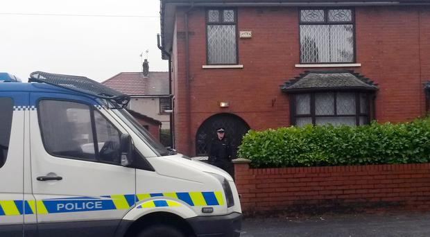 Police outside the home of Labour councillor Shakil Ahmed